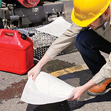 Oil Selective Absorbent Pad cleaning up a gasoline spill
